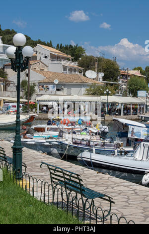 the harbour and walkway in kassiopi, corfu, Greece. - Stock Photo