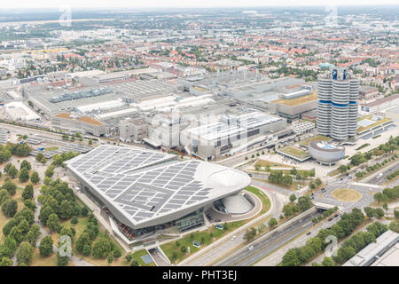 MUNICH, GERMANY - AUG 1, 2015: Aerial view of Munich with BMW buildings from Olympic communication tower on August 1, 2015 in Munich, Germany - Stock Photo