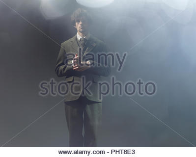 Young man wearing suit - Stock Photo