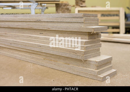 wooden parts for assembly in a furniture workshop - Stock Photo