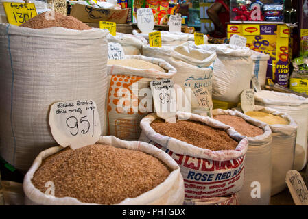 Horizontal close up of sacks full of traditional reed rice for sale in Sri Lanka. - Stock Photo