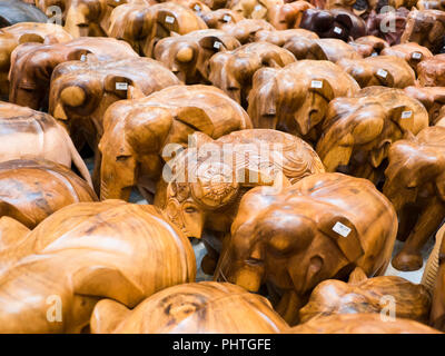 Horizontal close up of wooden elephant ornaments for sale in Sri Lanka. - Stock Photo