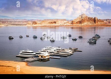 Boats dock at a marina on Lake Powell near Page, Arizona. - Stock Photo