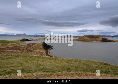 Rootless cones on the shore of Lake Myvatn in northern Iceland - Stock Photo
