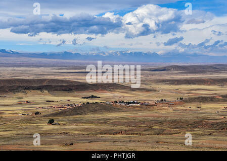 Panoramic view across the altiplano and the mountains of the Cordillera Real, near La Paz, Bolivia - Stock Photo