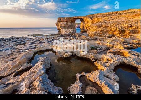 Azure Window in Gozo Malta at Sunset - Stock Photo