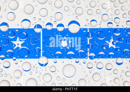 Flags  of Somalia behind a glass covered with raindrops. 3D illustration - Stock Photo