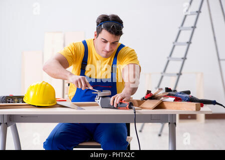 Floor repairman disappointed with his work - Stock Photo