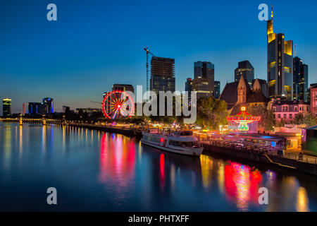 FRANKFURT AM MAIN, GERMANY - August  07, 2017: Frankfurt am Main - the business capital of Germany at night. View of illuminated skyscrapers - Stock Photo