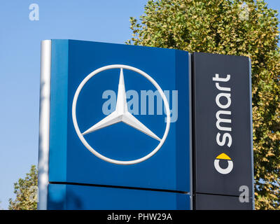 BELGRADE, SERBIA - SEPTEMBER 1, 2018: Mercedes Benz logo on their main dealership store Belgrade. Part of Daimler Group, Mercedes Benz is a German car - Stock Photo