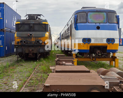 Lines of old Trains, both diesel and Electric stored at the Marine Container Port awaiting Disposal, Holland. - Stock Photo