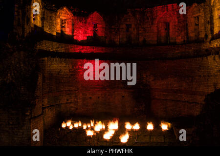 Floodlights and flames at St Mary's Abbey,Castle Museum Gardens,York,North Yorkshire,England,UK. - Stock Photo