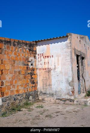 Old communist propaganda message written on a wall, Cunene Province, Cahama, Angola - Stock Photo