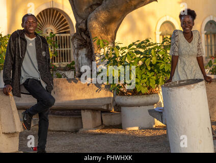Angolan students having a chat in a park, Benguela Province, Benguela, Angola - Stock Photo