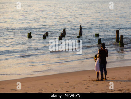 Angolan couple on the beach, Benguela Province, Benguela, Angola - Stock Photo