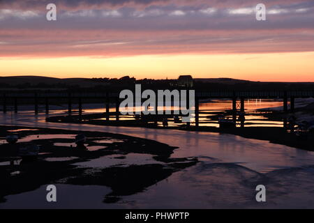 River Adur winds is way to the sea through Shoreham-by-Sea during a colourful sunset and reflection - Stock Photo