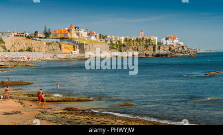 Estoril, Portugal - August 30th, 2018: Families on beach at Poca Beach in Sao Joao do Estoril, 25km west of Lisbon - Stock Photo