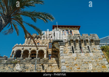 Estoril, Portugal - August 30th, 2018: Estoril on Lisbon's Sunshine coast - Historical fortified Baronial mansion overlooking the beach - Stock Photo