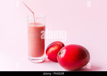 Fresh pink smoothie with peach and mango - Stock Photo