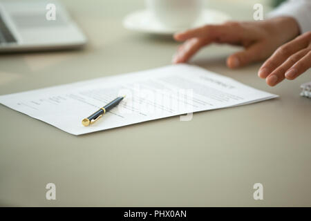 Offering to sign contract concept, legal document close up view - Stock Photo
