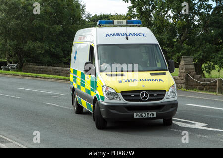 emergency ambulance paramedic urgent aid medic medical urgency assist first aid doctor rescue mercedes sprinter van - Stock Photo