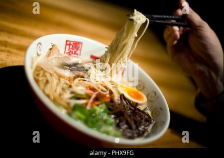 Photo shows soup noodles prepared at Hakata Ippudo Ramen's main store in the Daimyo district of Fukuoka City, Fukuoka Prefecture Japan on 08 March 201 - Stock Photo