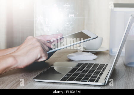 Internet of things concept,Man using tablet with modern technologies business and technology concept - Stock Photo
