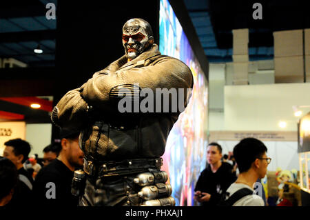 Fiction super villain action figure character of Bane from DC movies and comic. Bane action figure toys in various size display for the public. - Stock Photo