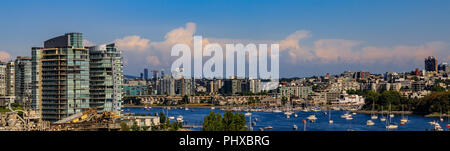 City skyline and waterfront with boats on False Creek from Granville Bridge in Vancouver, Canada. - Stock Photo