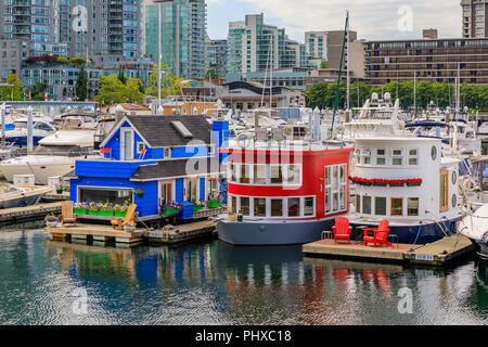 Vancouver, Canada - August 04, 2018: Houseboats docked in the marina at the Coal Harbour waterfront - Stock Photo