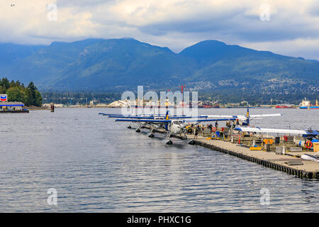 Vancouver, Canada - August 04, 2018:  De Havilland Beaver sea planes docked at Vancouver's Harbour Airport in Coal Harbour district - Stock Photo