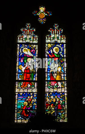 Marazion, England -  May 2018 : Victorian stained glass church window in St Michael`s Mount castle chapel, depicting saints and various religious scen - Stock Photo