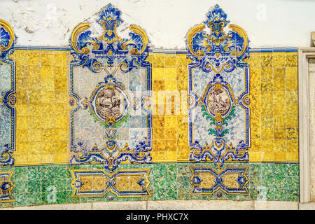Fragment of the old historical building and azulejos (painted tin-glazed ceramic tilework) located in Alcantara area, Lisbon, Portugal. - Stock Photo