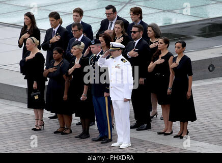 Washington, District of Columbia, USA. 1st Sep, 2018. WASHINGTON, DC - SEPTEMBER 01: Members of the McCain family watch as a military honor guard team carries the casket of the late-Sen. John McCain (R-AZ) from the U.S. Capitol September 1, 2018 in Washington, DC. The late senator died August 25 at the age of 81 after a long battle with brain cancer. Sen. McCain will be buried at his final resting place at the U.S. Naval Academy on Sunday. Credit: Win McNamee/Pool via CNP Credit: Win Mcnamee/CNP/ZUMA Wire/Alamy Live News - Stock Photo