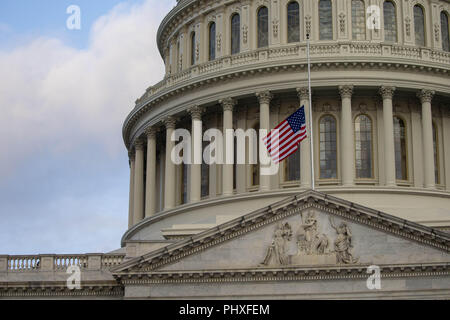 August 31, 2018 - Washington, District of Columbia, U.S. - The US flag is seen at half staff above the United States Capitol on the morning that a United States Military Honor Guard carries the casket of former Senator John McCain, Republican of Arizona, up the stairs of the Capitol in Washington, DC on August 31, 2018 in Washington, DC. McCain, a United States Military veteran and longtime Senator, will lay in state inside the Capitol Rotunda for one day prior to being laid to rest on September 1, 2018 at the United States Naval Academy in Annapolis, Maryland. Credit: Alex Edelman/CNP (Cred - Stock Photo