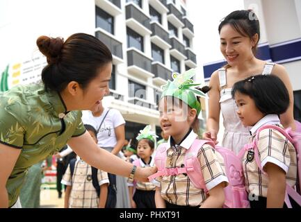 Nanning, China's Guangxi Zhuang Autonomous Region. 3rd Sep, 2018. Students talk to teacher at Yifu primary school in Nanning, south China's Guangxi Zhuang Autonomous Region, Sept. 3, 2018. Schools all over the country prepare various activities for students to greet the new semester. Credit: Zhou Hua/Xinhua/Alamy Live News - Stock Photo