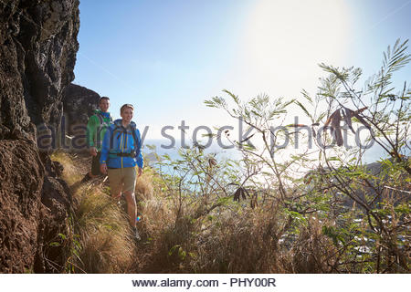 Couple hiking by cliff - Stock Photo