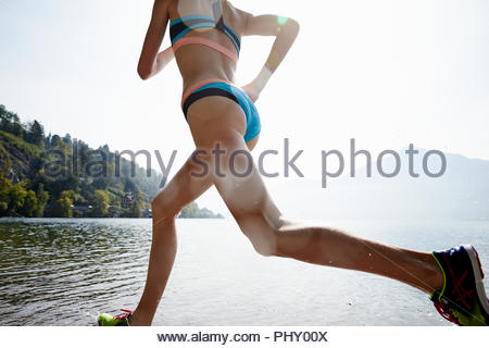 Young woman weightlifting - Stock Photo