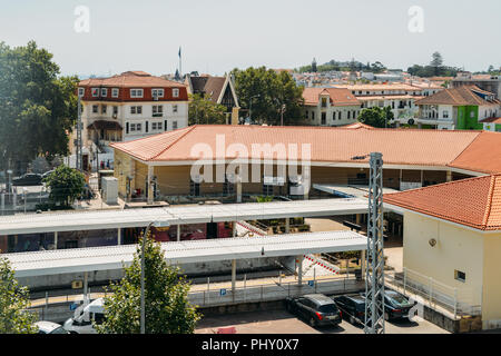 Cascais, Portugal - August 30, 2018: High perspective view of commuters at Cascais railway station, 30km west of Lisbon, Portugal - Stock Photo