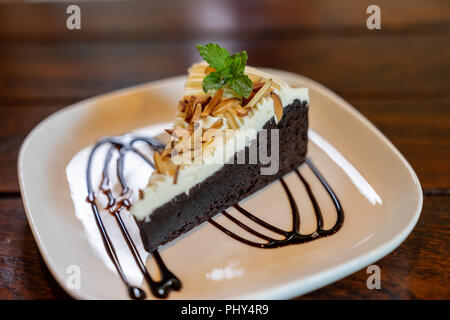 Close up chocolate cake homemade on wooden table - Stock Photo
