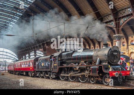 York.  Railway station. Steam train the Scarborough Spa Express hauled by Black Five Leander. - Stock Photo