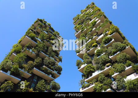 MILAN, ITALY - JULY 30, 2018: Modern and ecologic skyscrapers with many trees on every balcony. Bosco Verticale, Milan, Italy - Stock Photo