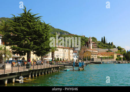 LAKE ISEO, ITALY - AUGUST 20, 2018: view of small village with church on Lake Iseo, Italy - Stock Photo