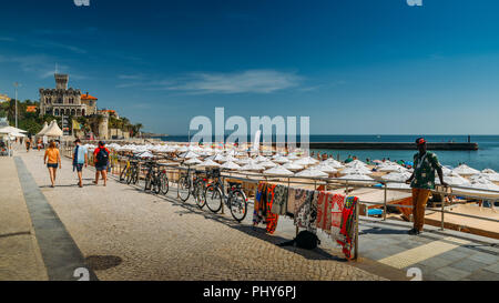Estoril, Portugal - August 30th, 2018: Boardwalk at Praia do Tamariz beach in Estoril, a popular beach with excellent infrastructure - Stock Photo