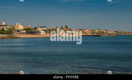 Estoril, Portugal - August 30th, 2018: Panoramic view of Estoril's Praia do Tamariz beach, a popular resort destination with excellent infrastructure - Stock Photo