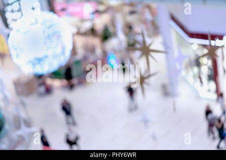 Abstract blurred background of Christmas decorated shopping mall - Stock Photo