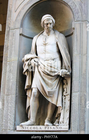 Statue of Nicola Pisano, an Italian sculptor whose work is noted for its classical Roman sculptural style, in the Uffizi Colonnade in Florence, Italy. - Stock Photo