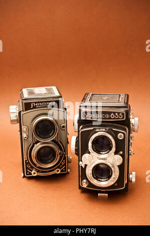 two vintage TLR cameras, a Yashica 635 and Flexaret automat - Stock Photo