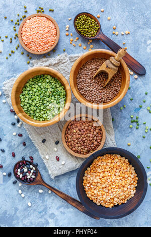 Green and yellow peas, mung and lentils in bowls. - Stock Photo