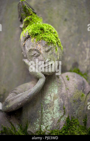 Photo shows a stone Buddha statue on display in the gardens of the Nezu Museum of Art in, Tokyo, Japan on 17 Sept. 2012. The  museum was  first concep